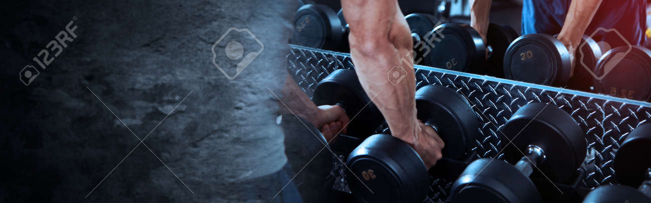 Hands with dumbbells - 70111922