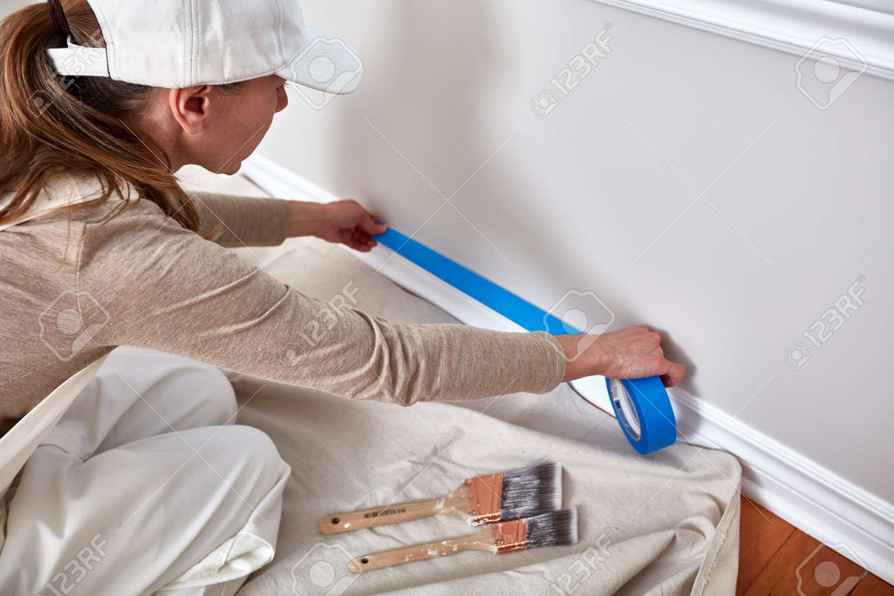 Woman painting wall - 76339460
