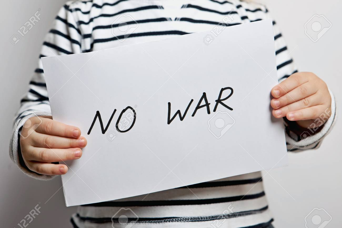 no war please text written on paper held by a child stock photo no war please text written on paper held by a child stock photo 41701555