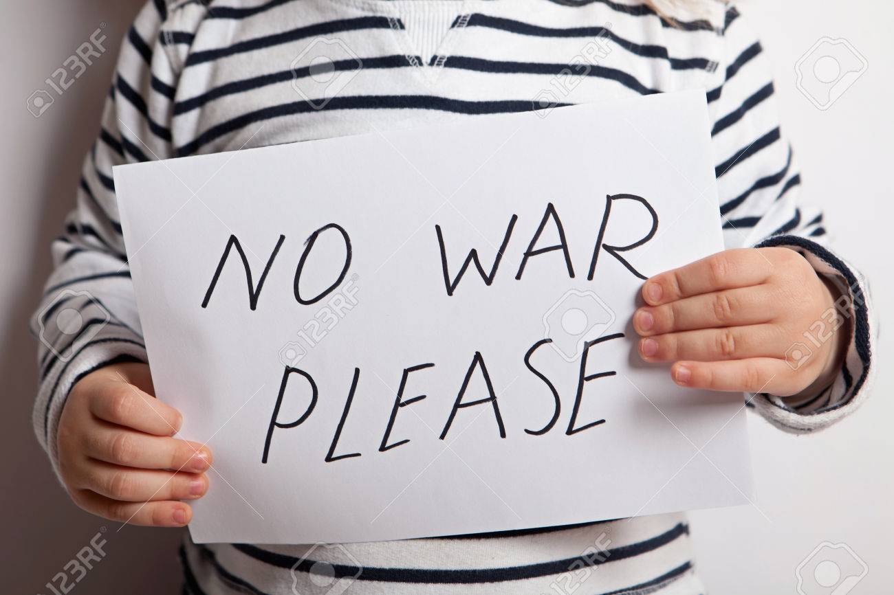 no war please text written on paper held by a child stock photo no war please text written on paper held by a child stock photo 42524801