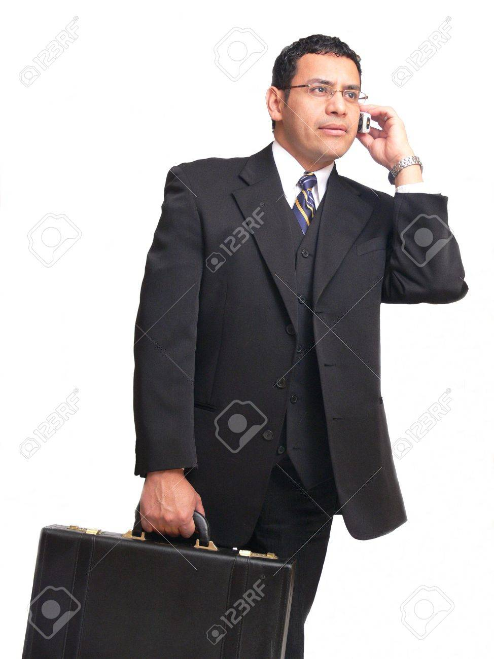 Businessman  60373	An businessman on the run is talking on his cell phone and carrying a	briefcase. Stock Photo - 847185