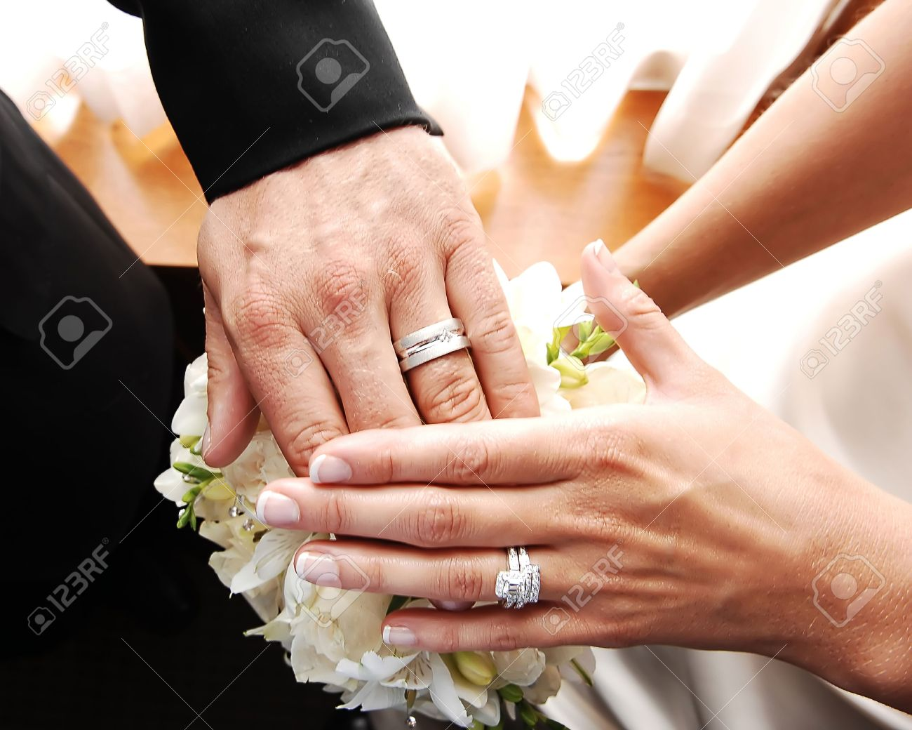 a just married couple shows there nice wedding rings on there finger stock photo - Nice Wedding Rings