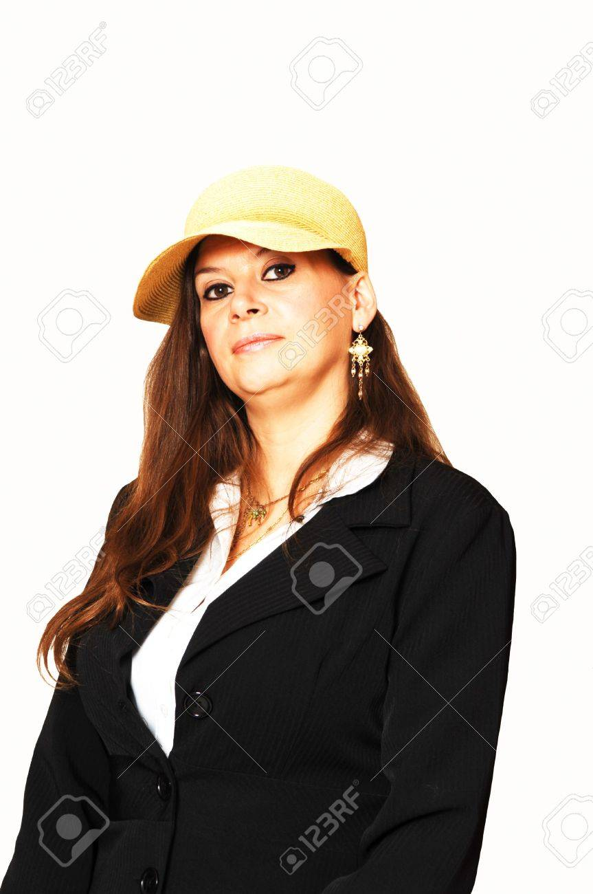 A middle age woman sitting in the studio for an portrait in a black jacket and bright yellow hat. On white background. Stock Photo - 4796440