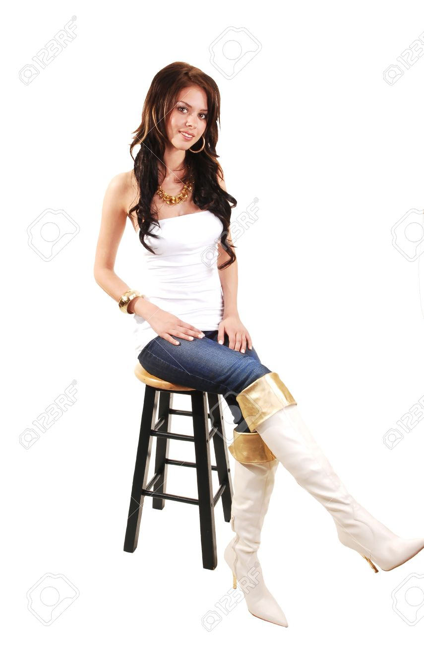 Beautiful Young Girl In Jeans And Long White Boots And Jeans ...