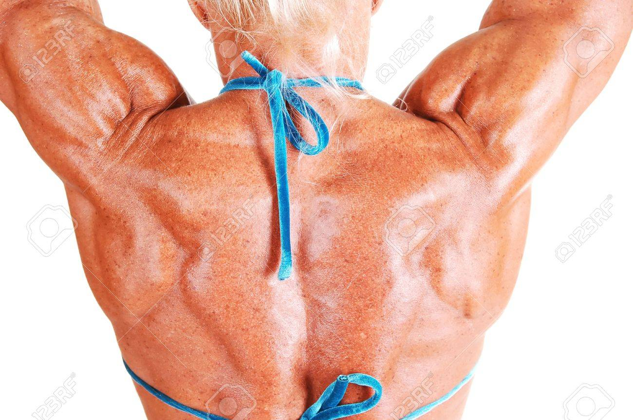 """Birchbox EL """"Beauté Tonique"""" - Page 4 5340143-Une-femme-bodybuilding-shooing-sa-partie-sup-rieure-du-dos-et-des-bras-muscl-s-shooing-les-muscles-f-Banque-d'images"""