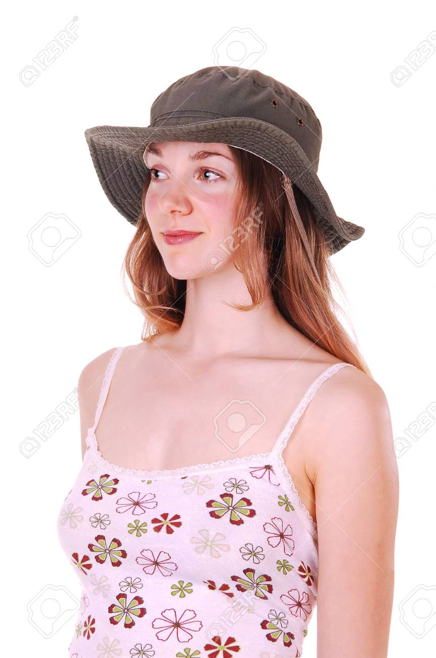 Beautiful young woman in a pink dress and an fabric hat smiling and looking away from the camera, on white background. Stock Photo - 5362628