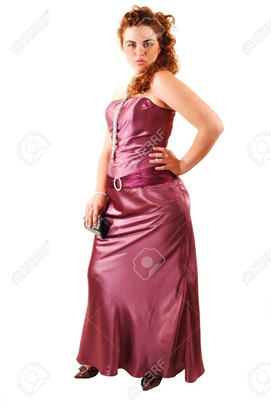 Hermosa Roja Pelo Mujer En Un Vestido De Noche Largo Rosa Con Un ...