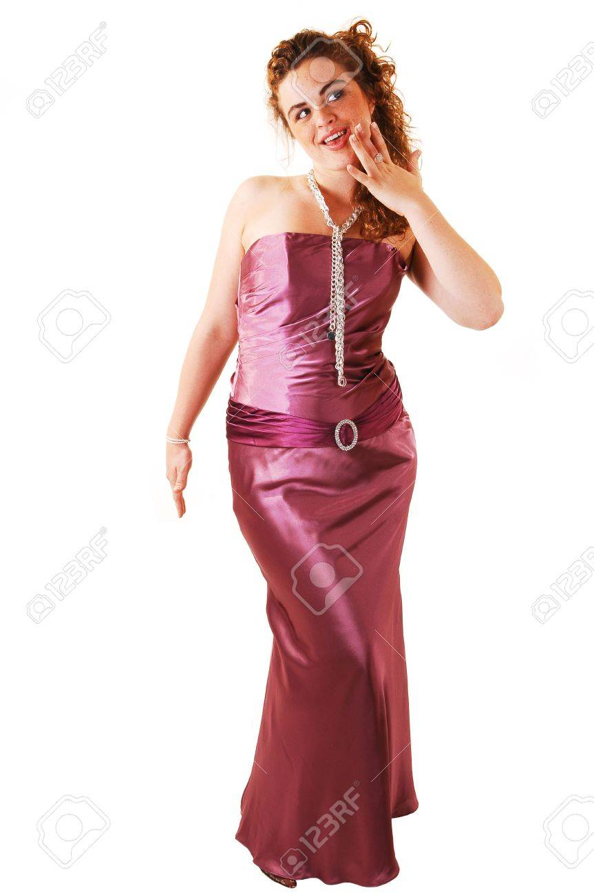 Beautiful Red Haired Woman In A Long Pink Evening Dress With A Pearl  Necklace And Small