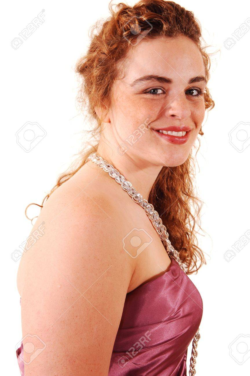 Beautiful Red Haired Woman In A Long Pink Evening Dress With A Pearl  Necklace In An