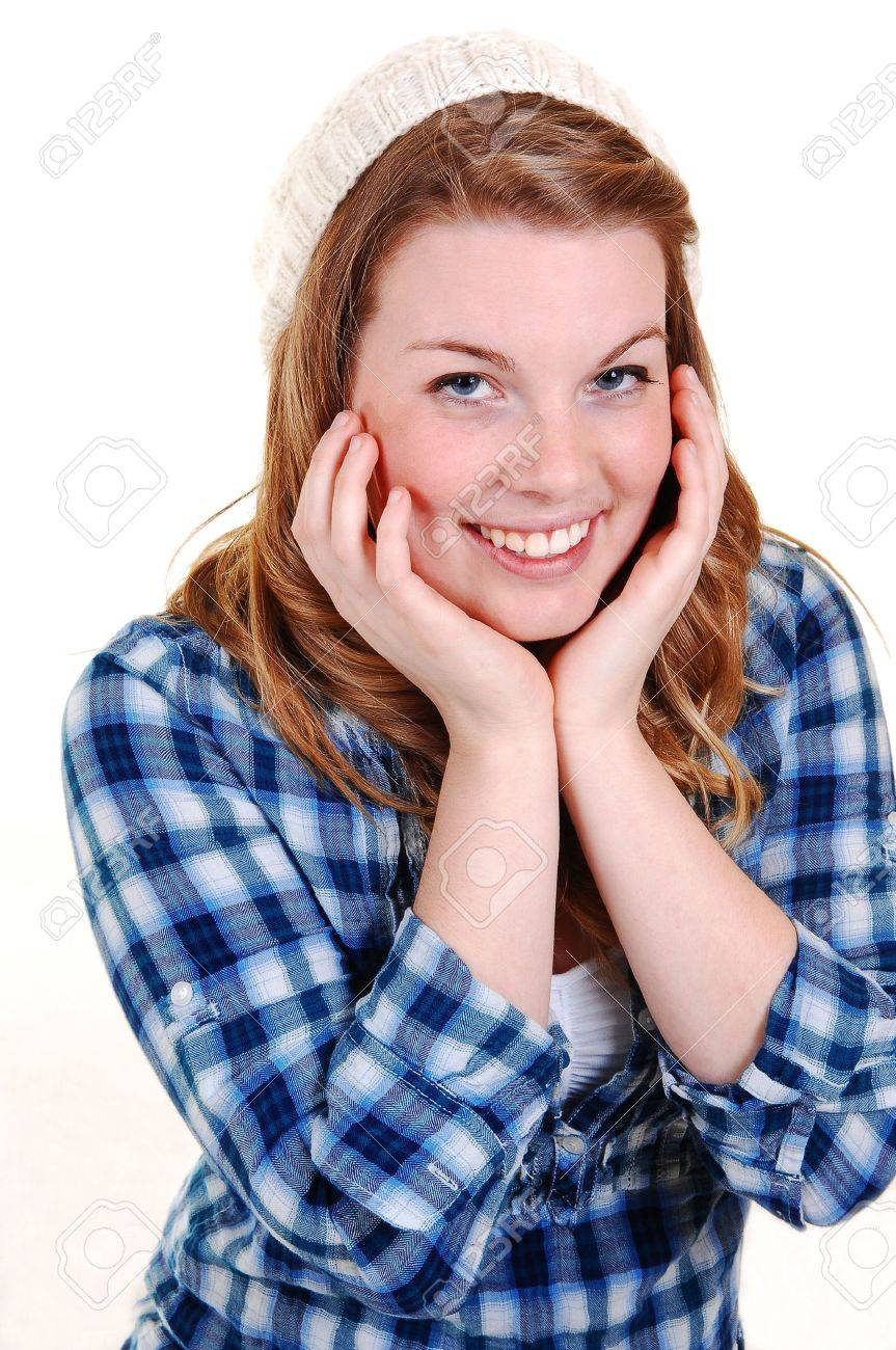 A portrait of a young pretty woman with blond hair and a had and blue blouse, holding her head in her hands, for white background. Stock Photo - 6454452