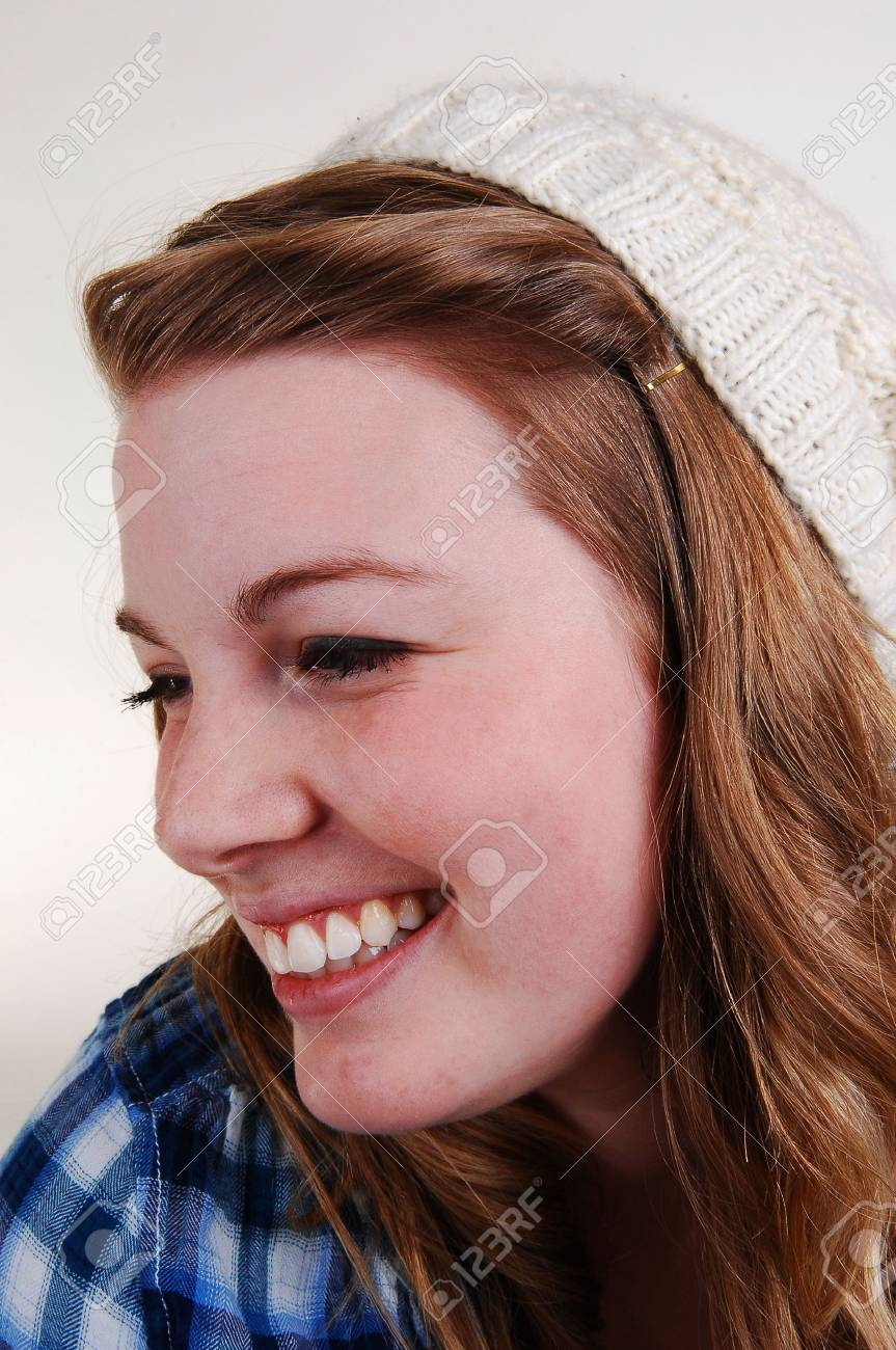 A pretty face with a had on her blond hair in closeup, smiling, for light gray background. Stock Photo - 6475055