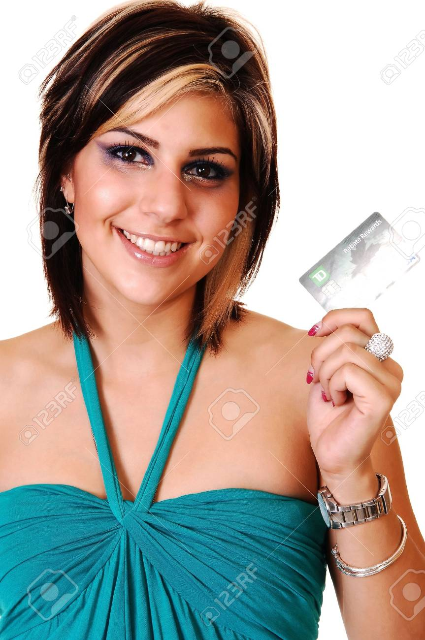 A beautiful young woman in a green blue dress and brunet hair shooing her credit card on the way to the mall, for white background. Stock Photo - 6764251