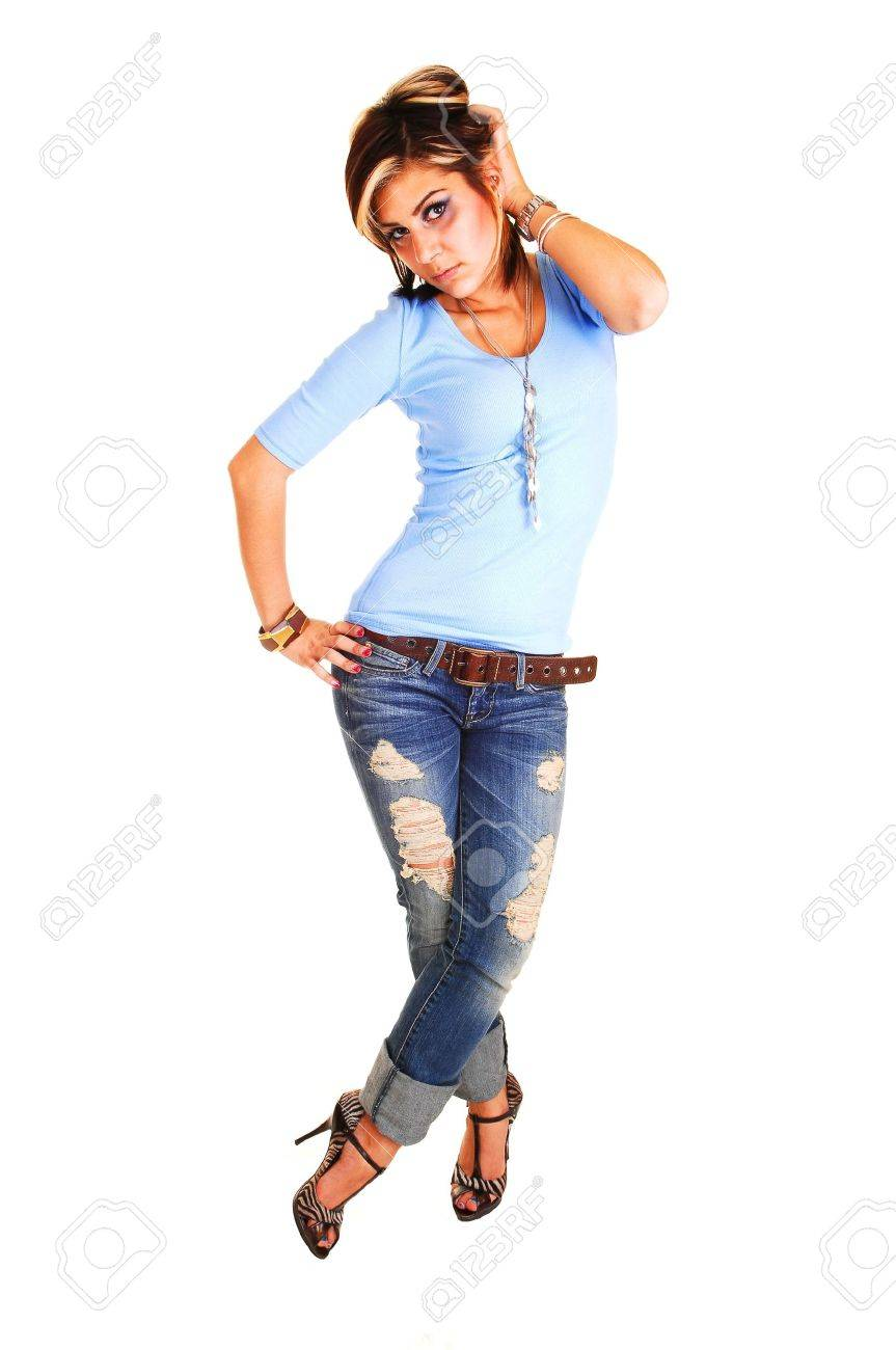 A pretty tall young girl standing with her front to the camera,  in high heels, jeans and blue sweater for white background. Stock Photo - 6764266