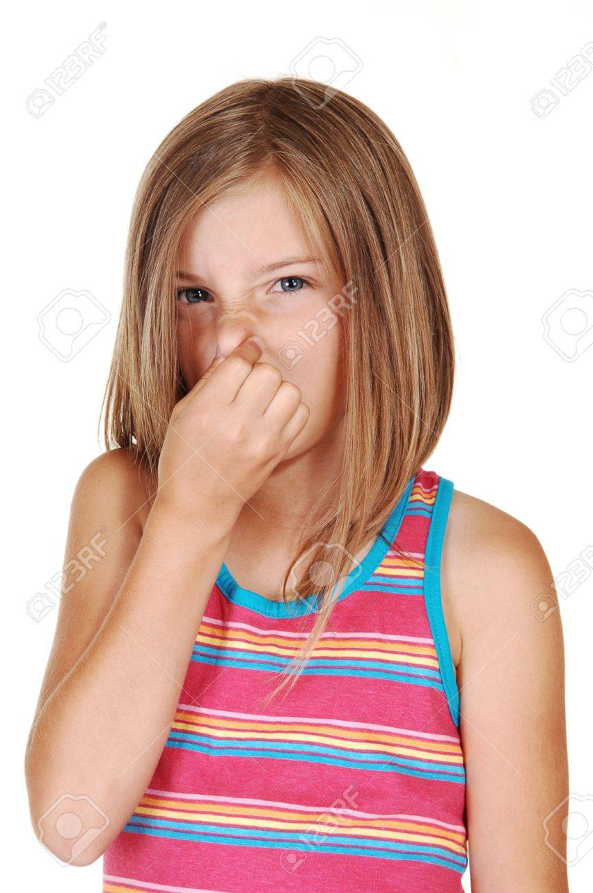 A lovely young girl with blond hair holds her nose closed for the smellin front of her, for white background. Stock Photo - 7333677