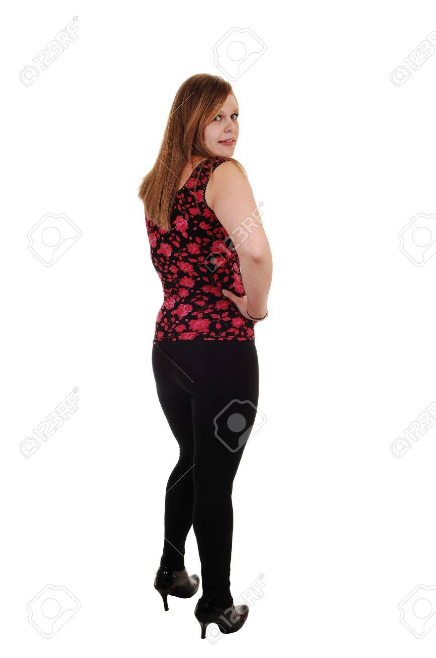c86efb223 An pretty blond woman in black tights and a red vest and high heels  standing in