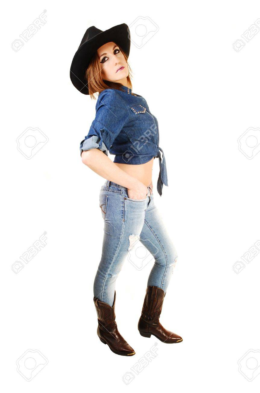 A Young Woman In Jeans And A Jeans Jacket Brown Boots And Black