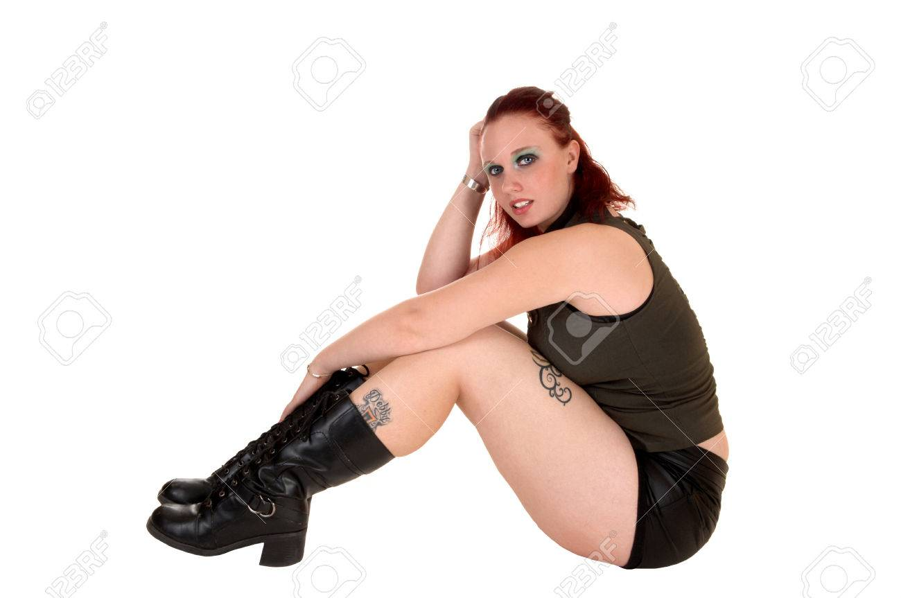 Teen redhead in leather boots