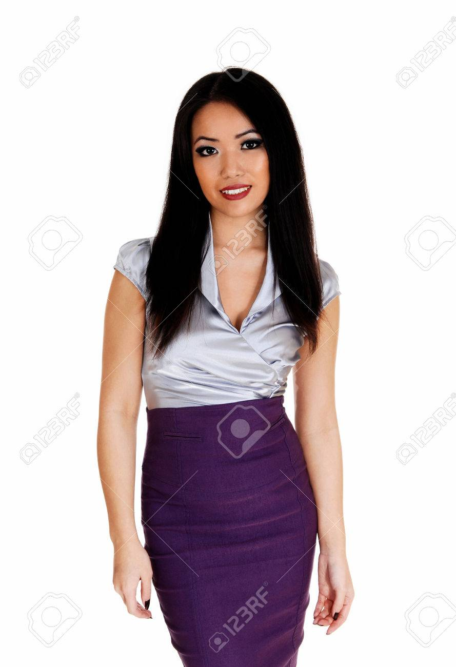 f05210c23f7047 A beautiful young slim Asian business woman in a silver blouse andlilac  skirt with long black