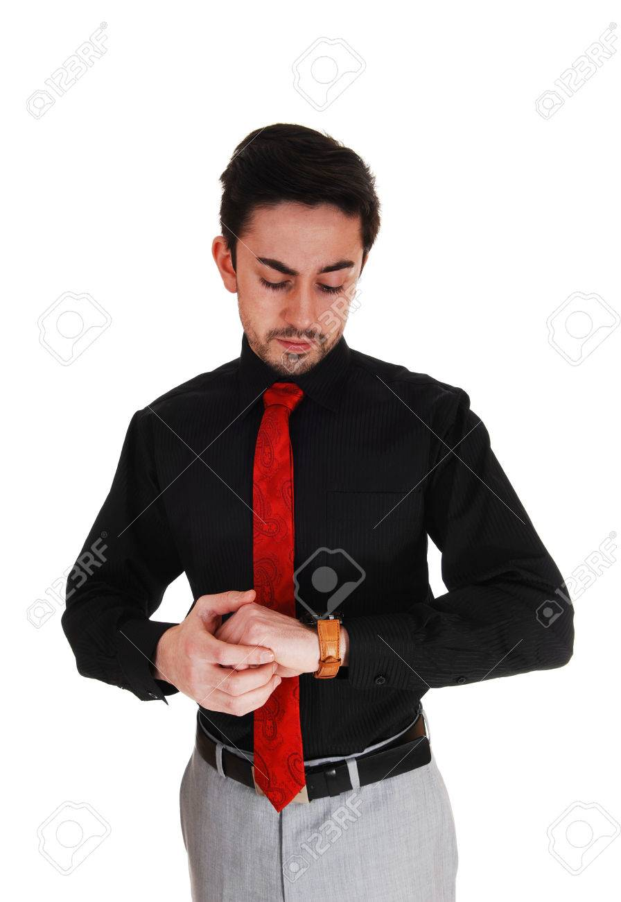 70979e6099d9 A closeup picture of a young man in a black shirt with red tie looking on