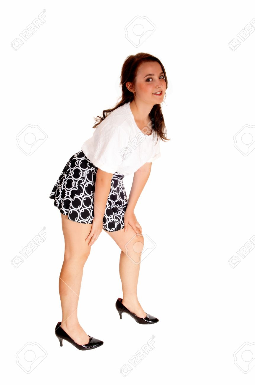 391e4f4d6 A pretty teenager girl in a white blouse and short skirt standing  isolatedfor white background