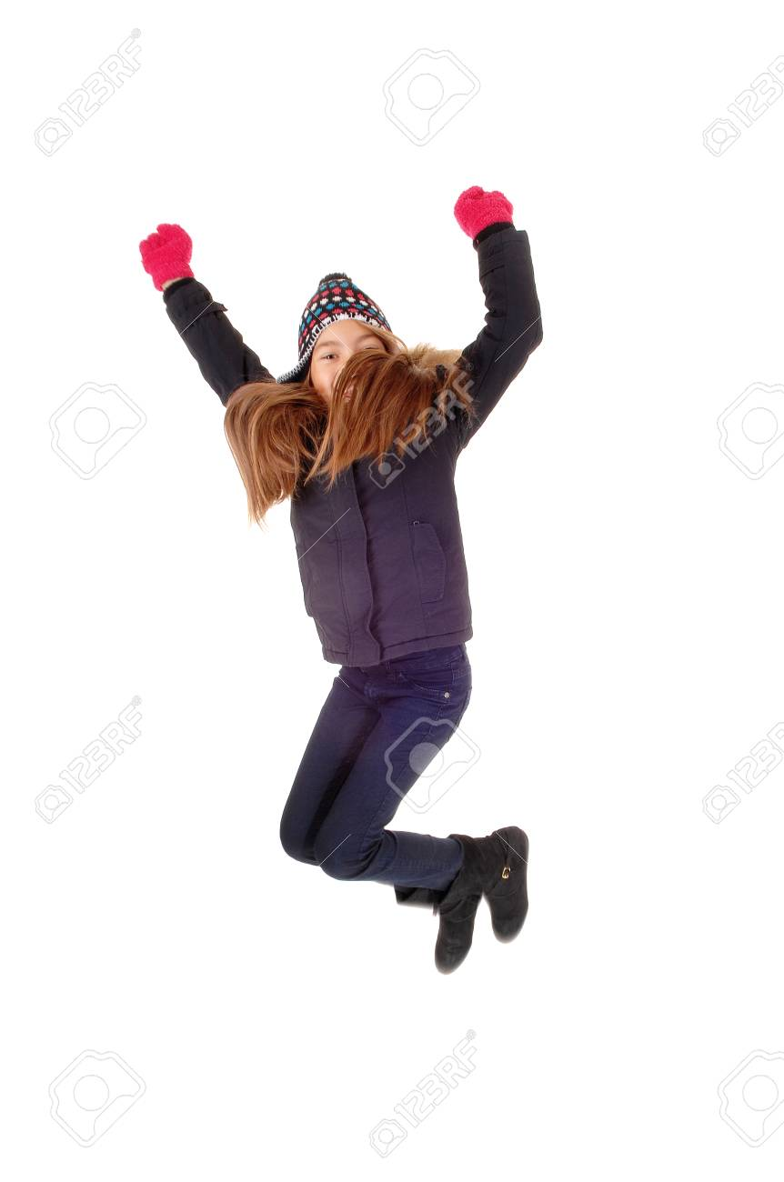 75cf038bb A Young Girl With Mittens And A Hat Jumping For Happiness