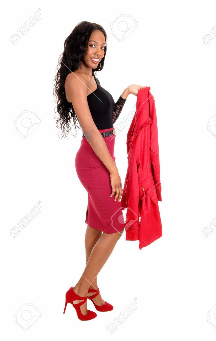 A tall slim young African American woman in a red skirt and black  blousestanding isolated for 67a8701d6