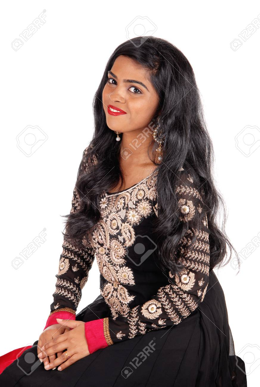 45cb1d401f A beautiful Indian woman in a native black dress and long black hair  sitting on a