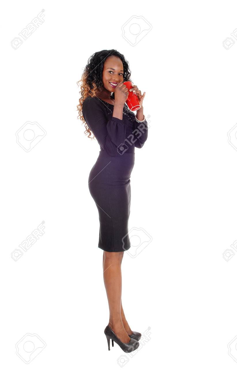 d4ea159a7786 A Gorgeous African American Woman Standing In A Short Gray Dress ...