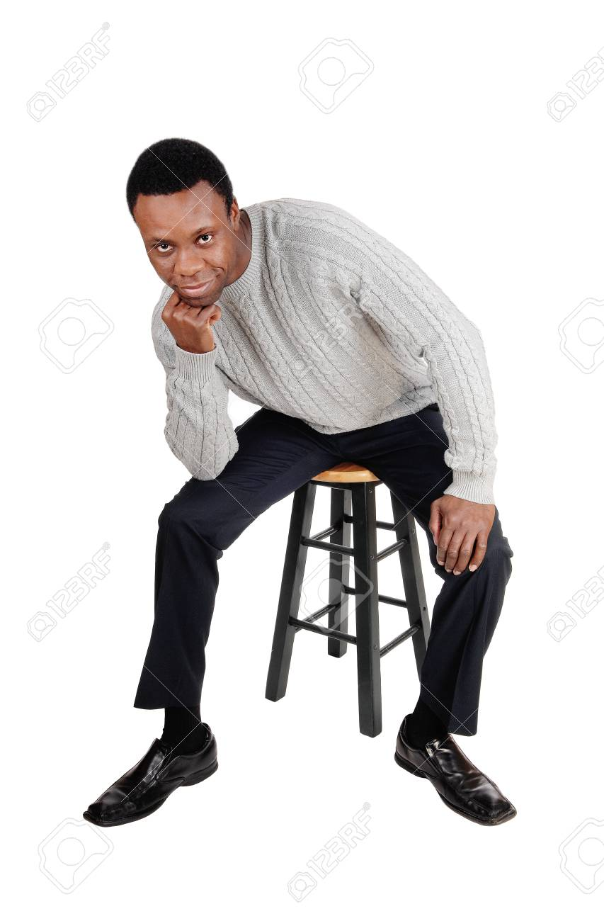 A full body image of a African American man in dress pants and sweater sitting on  sc 1 st  123RF.com & A Full Body Image Of A African American Man In Dress Pants And ...