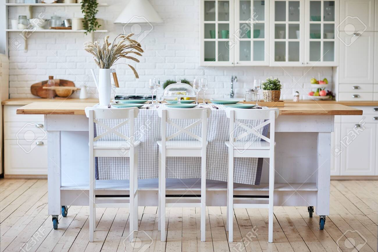 Beautiful White Wooden Kitchen With Island Table And Chairs Stock Photo Picture And Royalty Free Image Image 130506387
