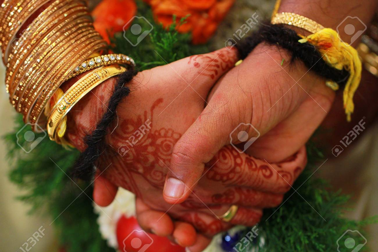 Closeup Joining Hands During An Indian Wedding Ritual Stock Photo Picture And Royalty Free Image Image 95412790