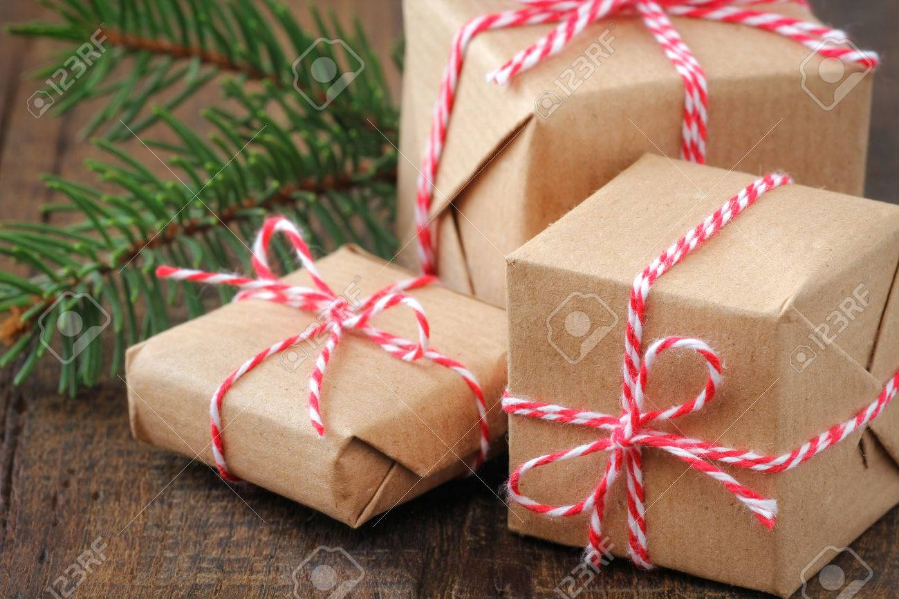 Three Handcrafted Christmas Gifts Wrapped In Brown Paper And.. Stock ...