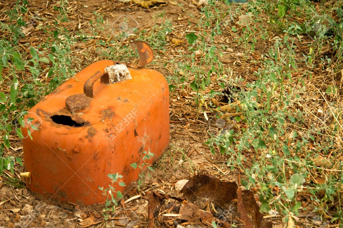 Rusty Gasoline Can; on the autumnal ground. Stock Photo - 7749114