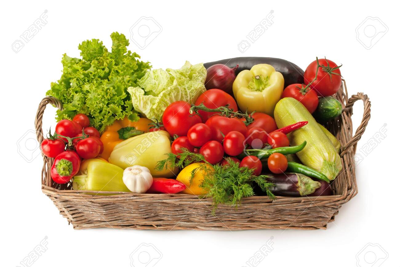 Fresh and ripe vegetables arranged in a basket isolated on white. Healthy organic food. - 140526627
