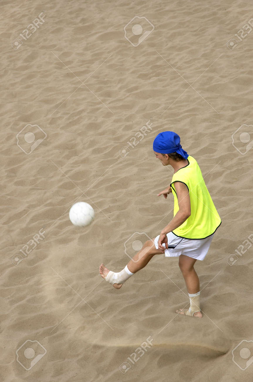 football-player on the sand Stock Photo - 246526