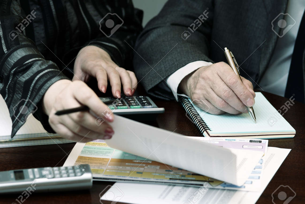 work with papers (focus on the pen(hand of the man),special toned) Stock Photo - 772528