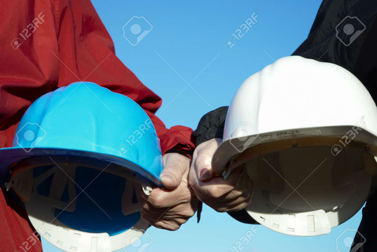 two hard-hats (blue and white color) focus on hand of man Stock Photo - 863187