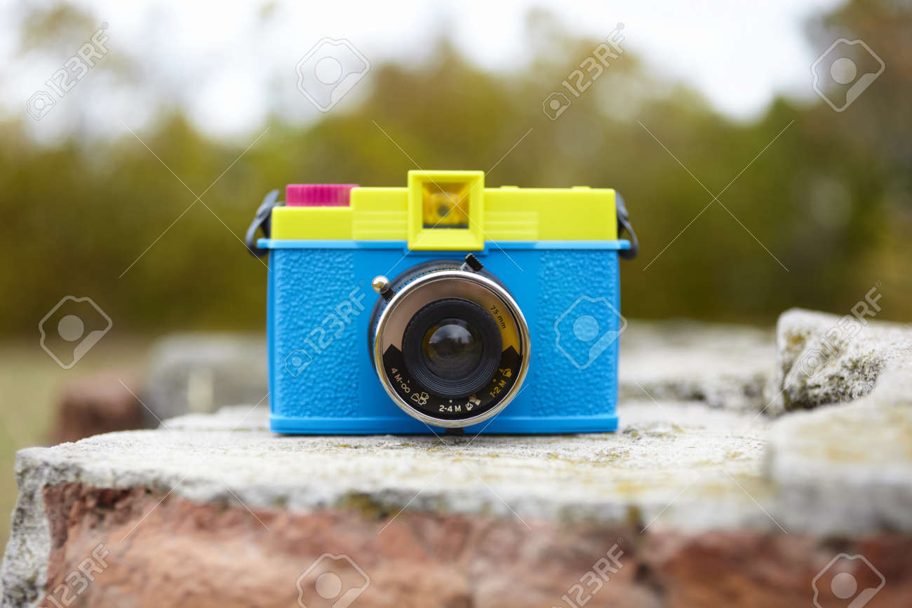plastic toy camera in closeup, selective focus on lens Stock Photo - 12319752