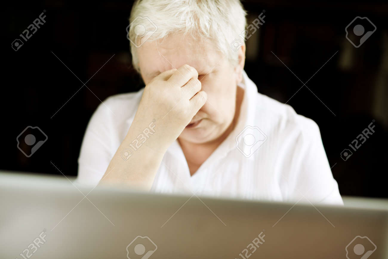 tired businesswoman with laptop,selective focus on the hand Stock Photo - 14250533