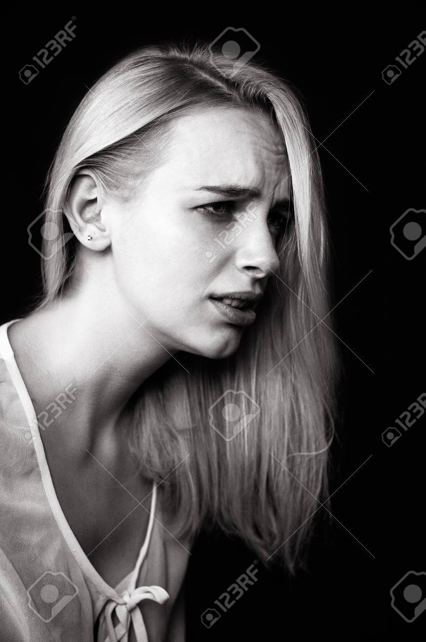 Beautiful girl cries demonstrating her sadness and emotions black and white photo depicting a