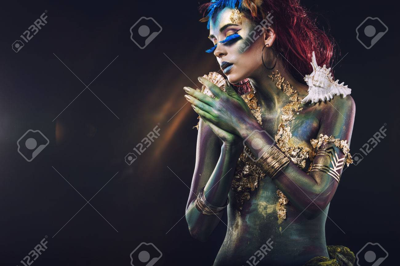 Beautiful young girl with body art in an unusual fantasy style - 61189625
