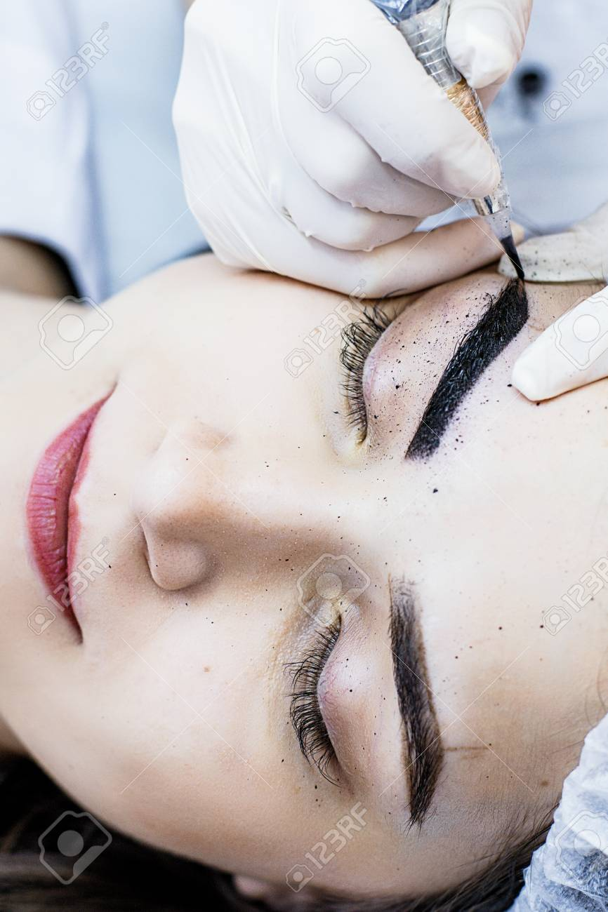Beautician Female Applies Permanent Makeup On Eyebrows, Tattoo ...