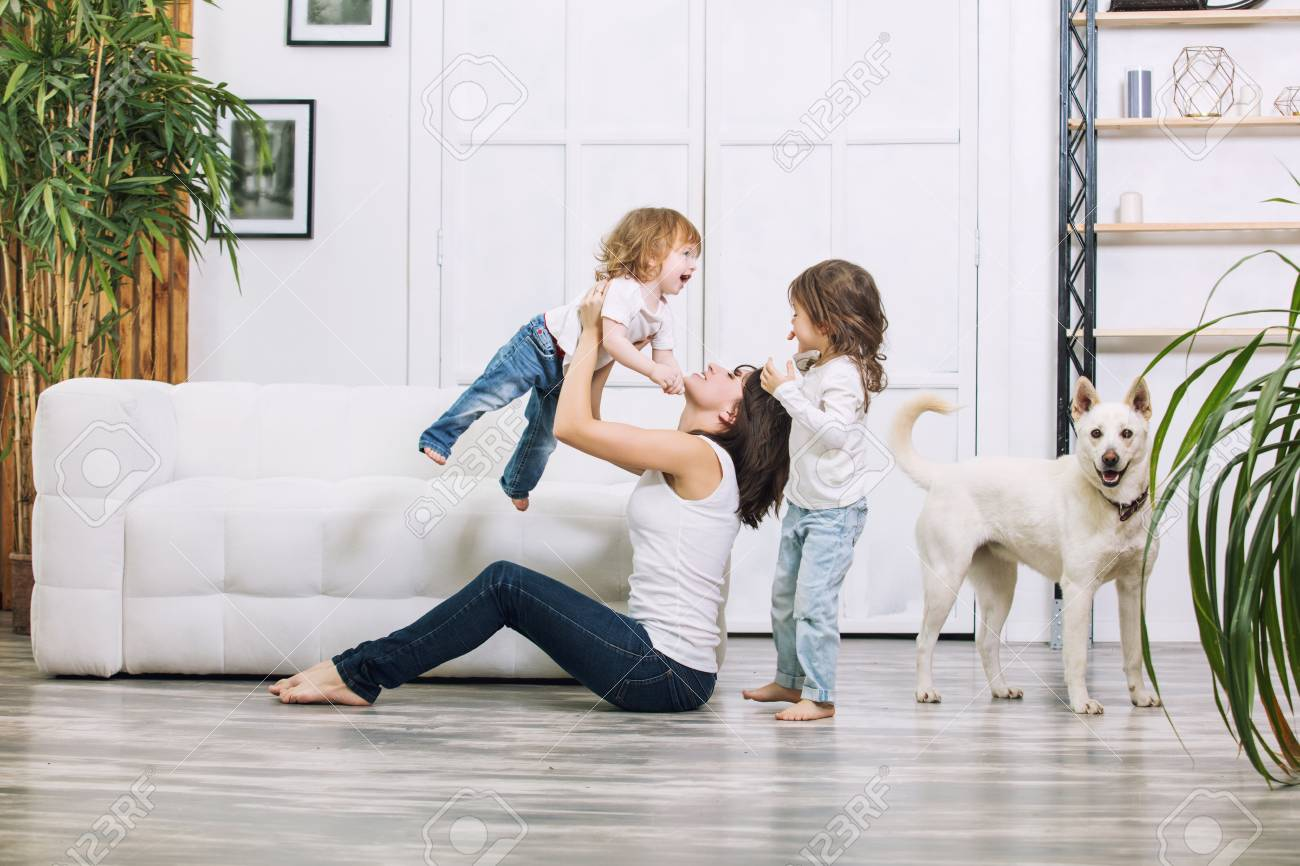 Little kids girls are beautiful and cute with mother and pet dog at home together happy - 119813162