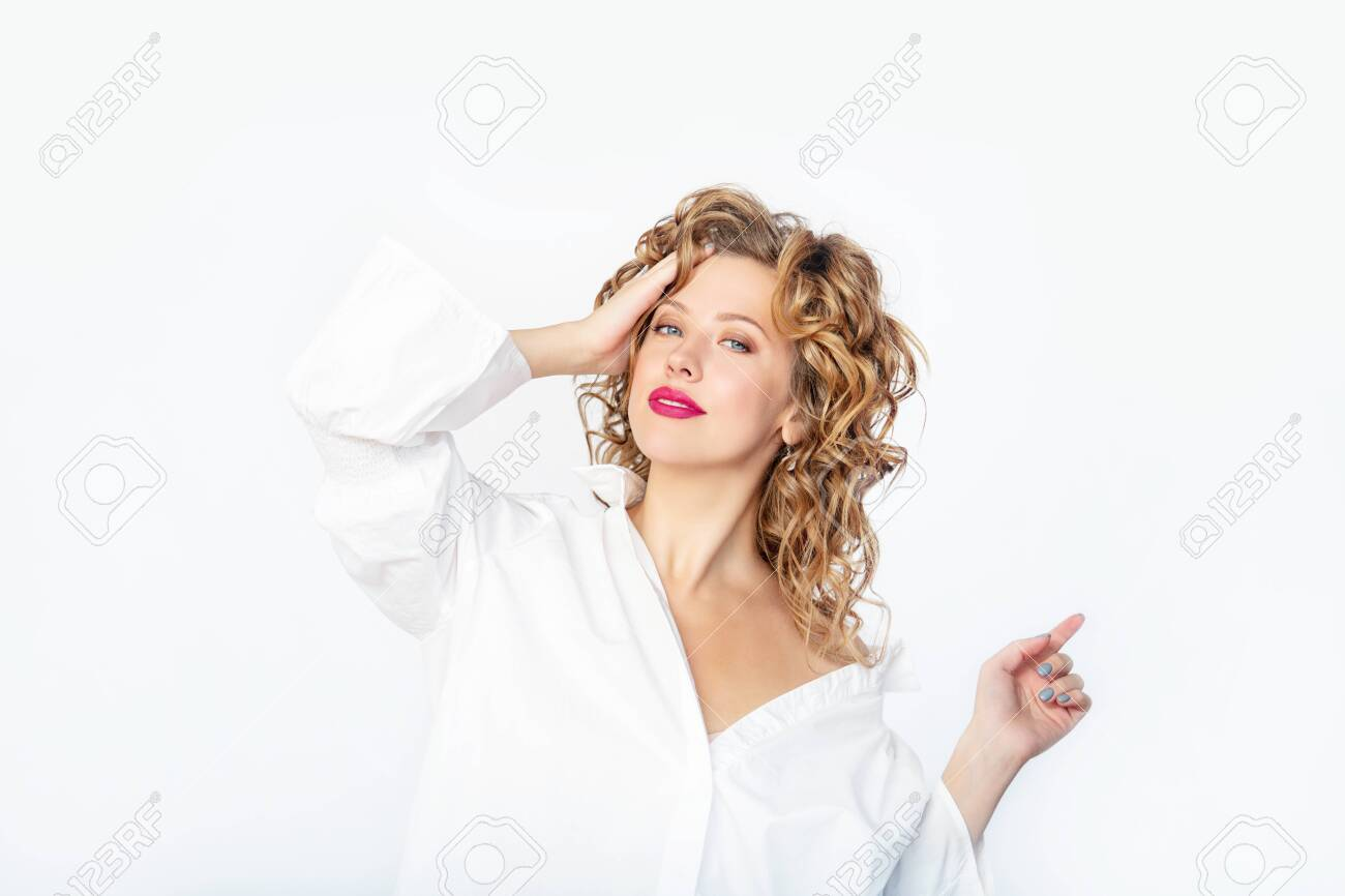 Young beautiful woman model fashionable and stylish on a white background in the Studio - 146945642