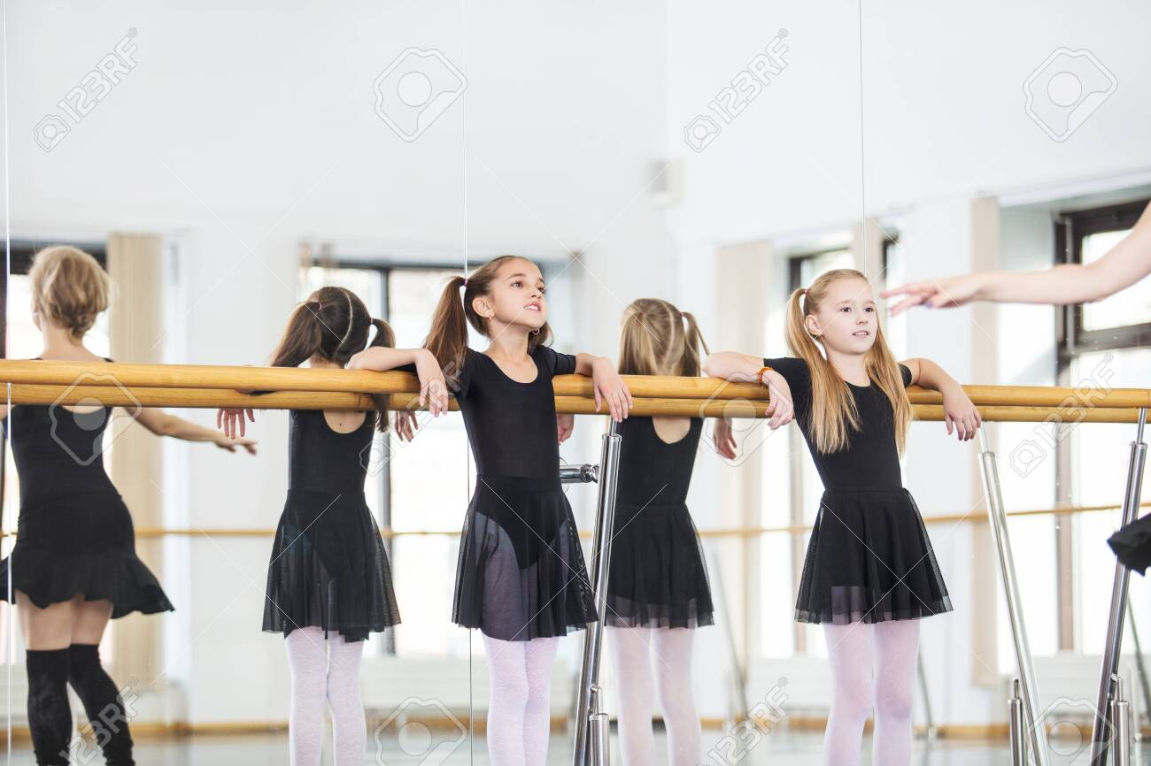 Small beautiful cute girls children in the Studio train with a coach at a dance lesson. - 147258558