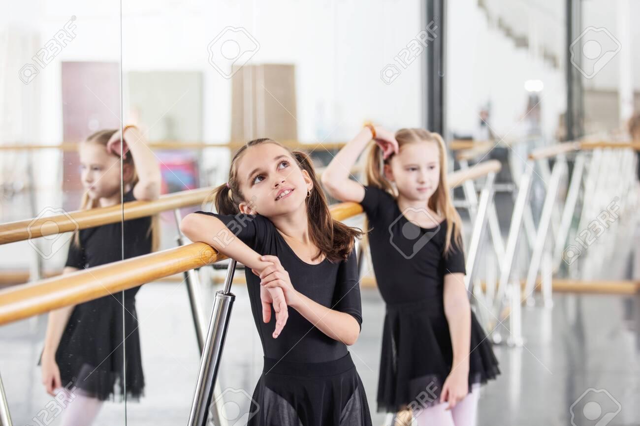 Small beautiful cute girls children in the Studio train at a dance lesson. - 147258563