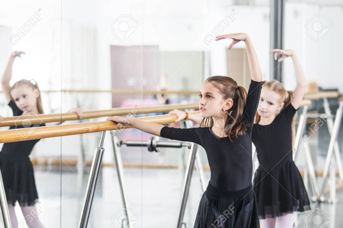 Small beautiful cute girls children in the Studio train at a dance lesson. - 147258565