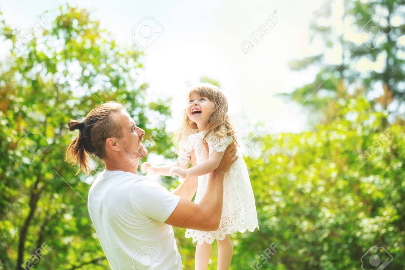 Happy beautiful family together father and daughter portrait on a walk on a Sunny summer day - 147993502