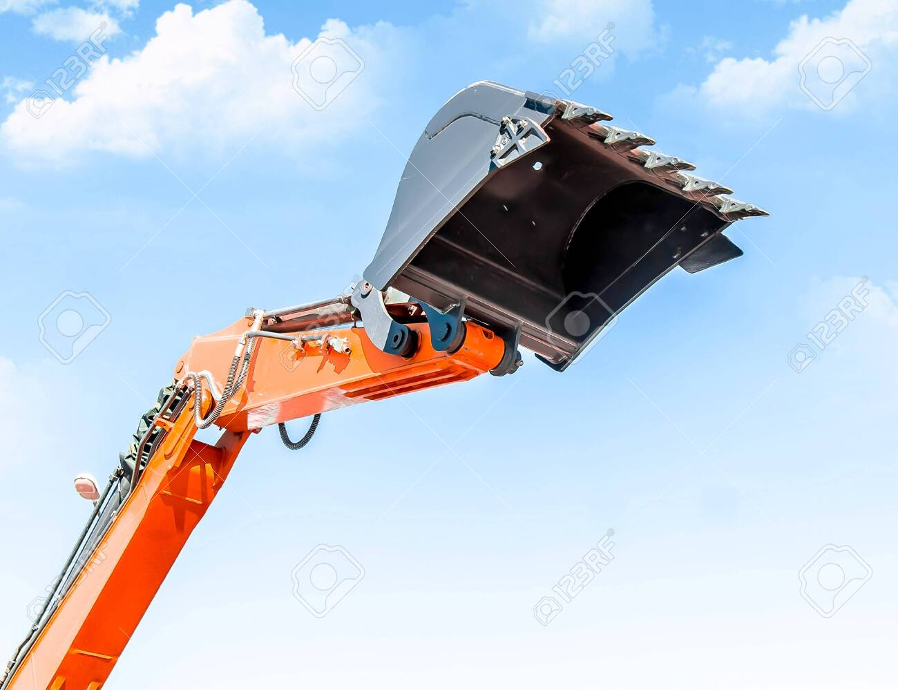 Excavator bucket against the sky - 123656179