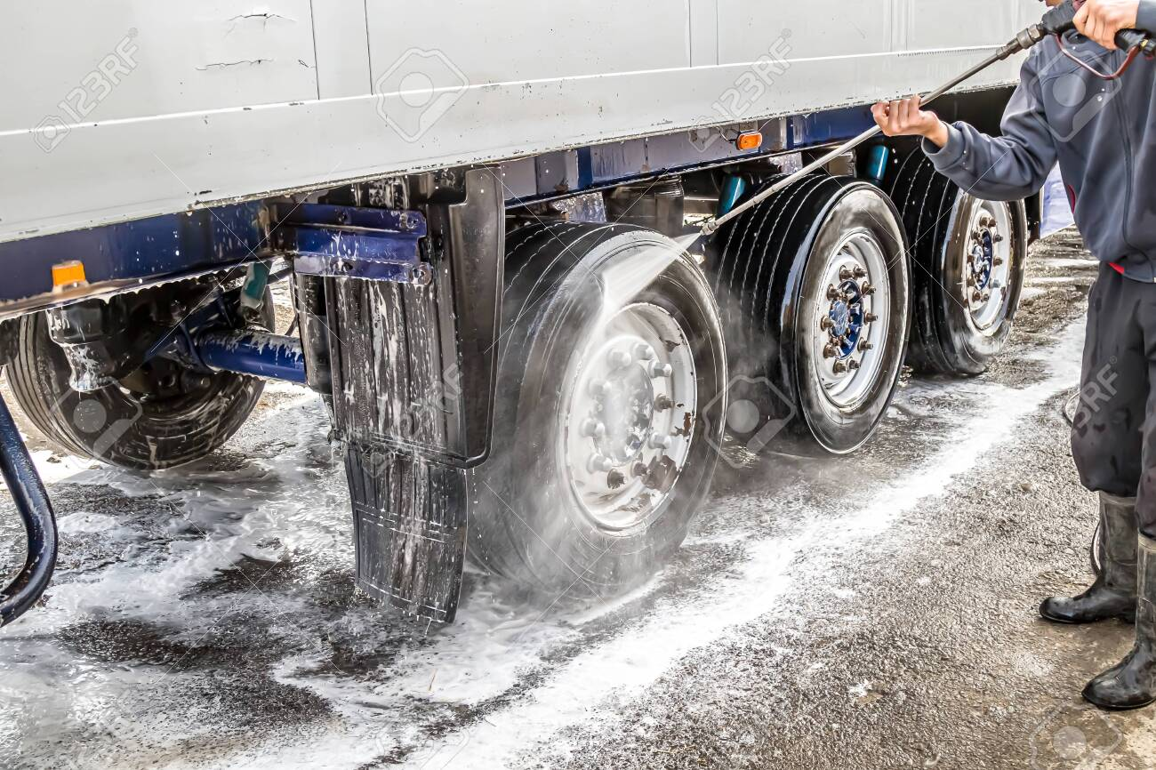 Washing a truck outdoors. Close-up. Car wash with detergents. - 136205852